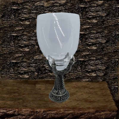 Glass chalice with foot of pewter eagle claw