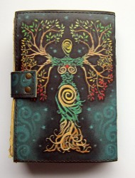 Book of Shadows Goddess in a tree intertwined with brass fittings